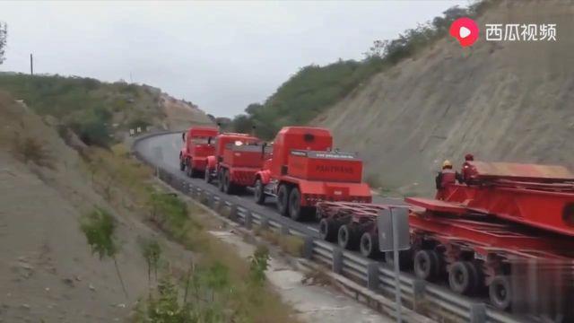 美国大件运输217吨爬坡要4辆车,国内估计2辆搞定!