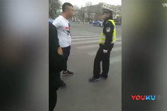 社会青年挑衅执勤交警 你没上岗证我让你回家放羊